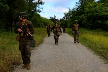 U.S. Marines with Headquarters Battalion, 3rd Marine Division, conduct a patrol during Samurai 20-1 on Camp Hansen, Okinawa, Japan, Oct. 22, 2019. The purpose of this exercise is to conduct battle drills that validate the 3rd Marine Division's movement, setup of a combat operations center, force protection, and passage of command and control between supporting elements. (U.S. Marine Corps photo by Sgt. David Staten)