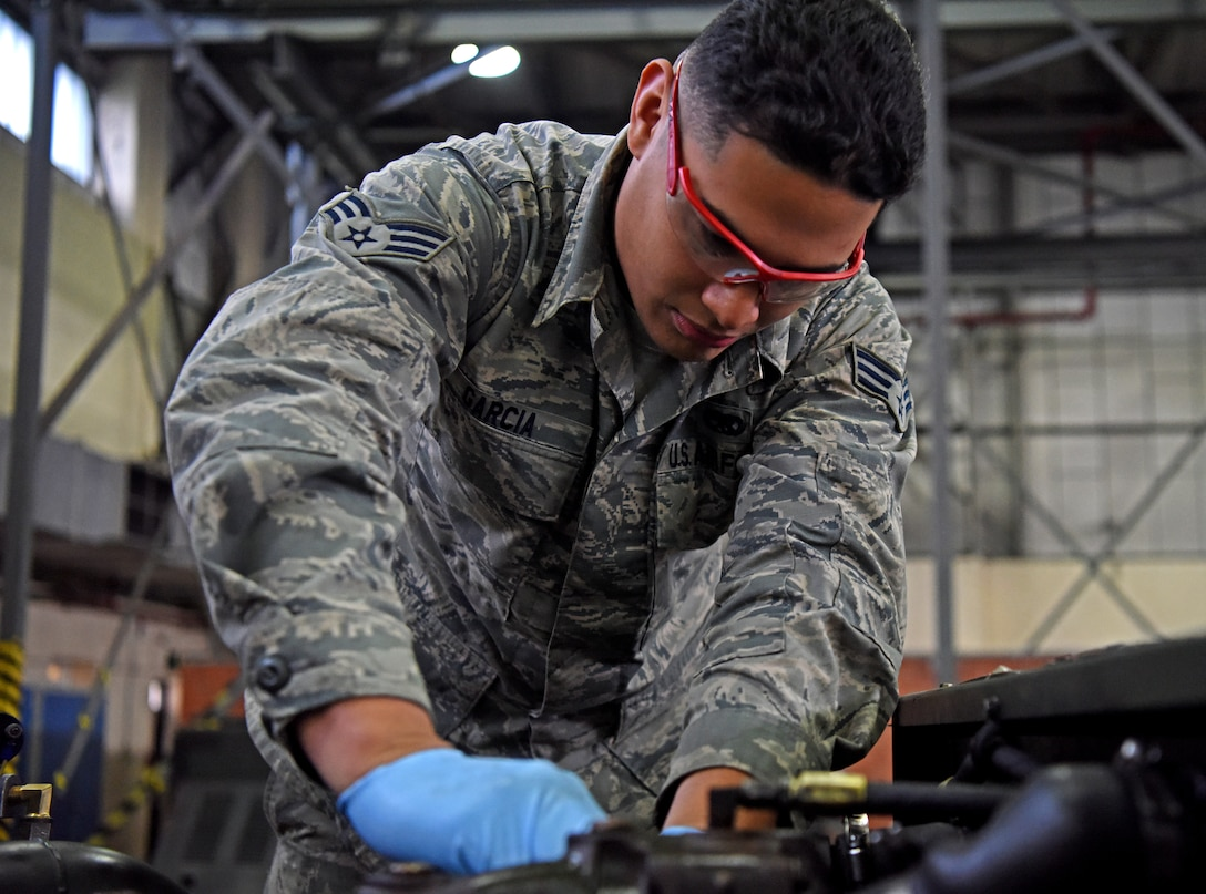 Senior Airman Antonio Garcia, 100th Maintenance Squadron aerospace ground equipment technician, repairs a ground power unit engine at RAF Mildenhall, England, Oct. 23, 2019. Repairs, updates and inspections are conducted on aerospace ground equipment to ensure everything is in proper working order. (U.S. Air Force photo by Senior Airman Brandon Esau)