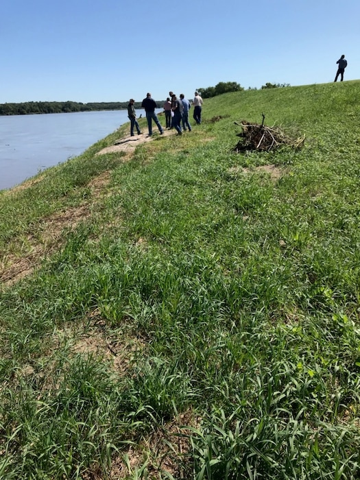 Pre-qualified contractors conduct a site visit at the Cedar Creek levee on Aug. 29, 2019 to view the scope of work on site in order to make an accurate bid.