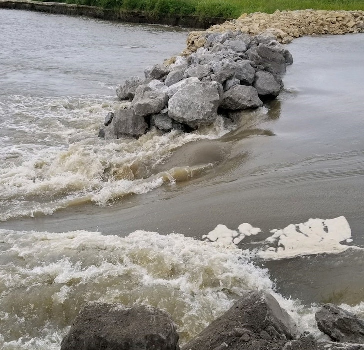 Image of final length of the north breach on Levee L550 near Watson, Missouri moments before closing, Aug. 24, 2019.