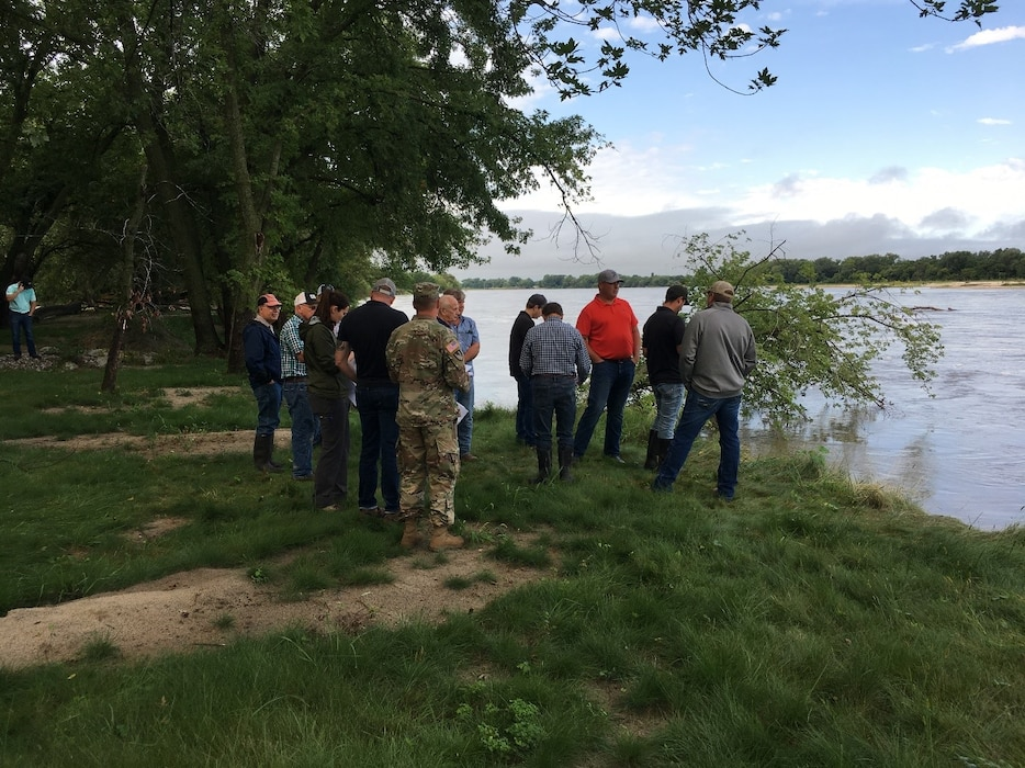 USACE contractors inspect the riverbank of the levee system during the pre-bid site visit conducted at Western Sarpy Aug. 28, 2019.