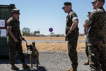 U.S. Marine Lt. Gen. Brian Beaudreault, II Marine Expeditionary Force commanding general, visits with a military working dog handler with Special Purpose Marine Air-Ground Task Force-Crisis Response-Africa 19.2, Marine Forces Europe and Africa, during a command visit to Moron Air Base, Spain, Aug. 24, 2019.