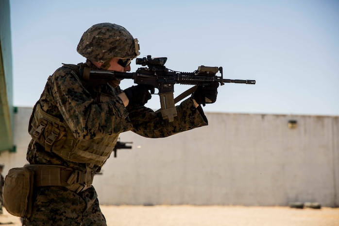 A U.S. Marine with Special Purpose Marine Air-Ground Task Force-Crisis Response-Africa 19.2, Marine Forces Europe and Africa, fires an M4 carbine during a table four range on Moron Air Base, Spain, Aug. 23, 2019.