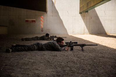 U.S. Marines with Special Purpose Marine Air-Ground Task Force-Crisis Response-Africa 19.2, Marine Forces Europe and Africa, fire an M110 semi-automatic sniper system at Moron Air Base, Spain, Aug. 30, 2019.