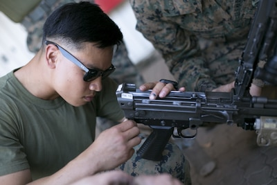Man performing weapons maintenance.