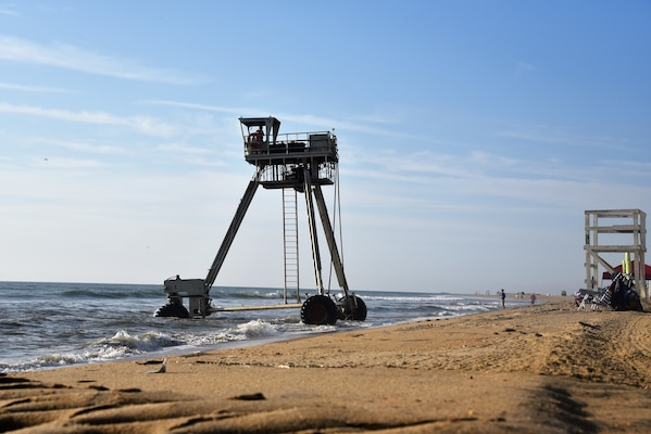 A coastal research amphibious buggy drive to the shoreline from the ocean