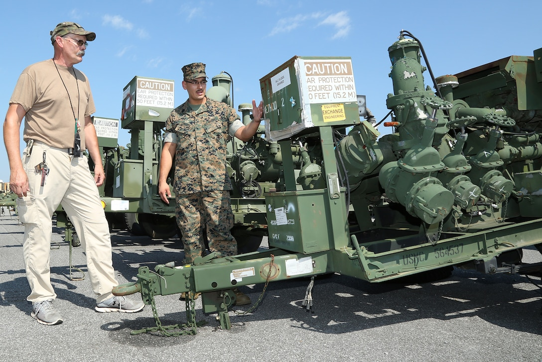 Gunnery Sgt. Michael E. Longoria, 2ND Marine Force Storage Battalion, Marine Force Storage Command, conducts a joint inspection with Mr. James Ogden, disposal service representative, Defense Logistics Agency (DLA) while at Marine Corps Logistics Base Albany, Georgia, August 2019. Marine Corps Logistics Command and DLA are working together to dispose of thousands of obsolete pieces of equipment in support of the Marine Corps' Equipment Optimization Plan.