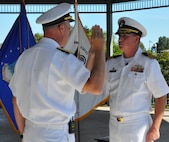 IMAGE: DAHLGREN, Va. (Aug. 30, 2019) – Rear Adm. Eric Ver Hage, Naval Sea Systems Command Warfare Centers commander, left, promotes Cmdr. Casey Plew to the rank of captain before family, friends, and colleagues at Naval Surface Warfare Center Dahlgren Division (NSWCDD). It was Plew's second ceremony marking a career milestone in four months. The new Navy captain took command of NSWCDD – the Naval Sea System Command's largest Naval Warfare Center – at a ceremony held on the Potomac River Test Range in April.