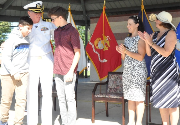 IMAGE: DAHLGREN, Va. (Aug. 30, 2019) – Family members congratulate Capt. Casey Plew during his promotion ceremony at Naval Surface Warfare Center Dahlgren Division (NSWCDD). It was Plew's second ceremony marking a career milestone in four months. The new Navy captain took command of NSWCDD – the Naval Sea System Command's largest Naval Warfare Center – at a ceremony held on the Potomac River Test Range in April.