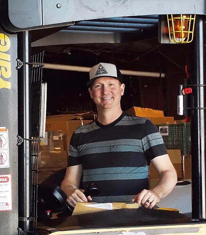 Image of Jared Grimshaw on a DLA forklift in a warehouse.