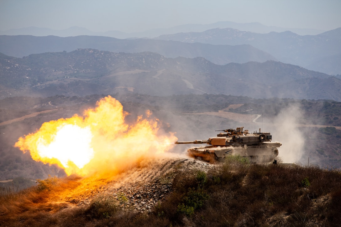 An M1A2 Abrams Main Battle Tank fires during the Tank Gunnery Competition, TIGERCOMP on Marine Corps Base Camp Pendleton, August 29. TIGERCOMP is an annual force competition that determines the Marine Corps' most lethal tank crew. The winning crew, 4th Tank Battalion, 4th Marine Division, Marine Forces Reserve, will have the opportunity represent the Marine Corps in the Sullivan Cup, which is the Army's total force tank gunnery competition.