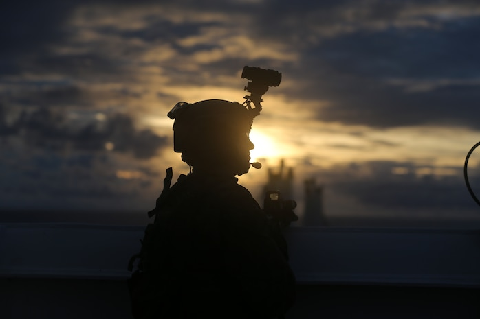 U.S. Marine Lance Cpl. Steven Rowe with 3rd Reconnaissance Battalion, 3rd Marine Division, posts security during a Visit, Board, Search, and Seizure training as part of exercise HYDRACRAB, Santa Rita, Guam, Aug. 27, 2019. HYDRACRAB is a multilateral exercise conducted by U.S. Marines and Sailors with military service members from Australia, Canada, and New Zealand. The purpose of this exercise is to prepare the participating explosive ordnance disposal forces to operate as an integrated, capable, and effective allied force ready to operate in a changing and complex maritime environment throughout the Indo-Pacific region.