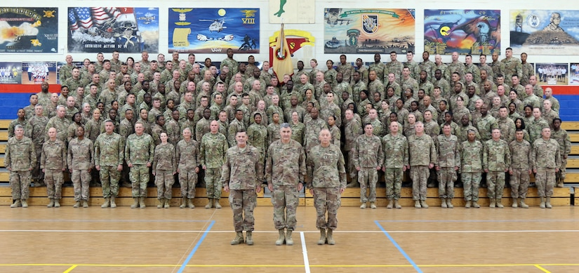 """Maj. Gen. Flem B. """"Donnie"""" Walker, commanding general of 1st Theater Sustainment Command, stands with 184th Sustainment Command at Camp Arifjan, Kuwait, June 1, 2019."""
