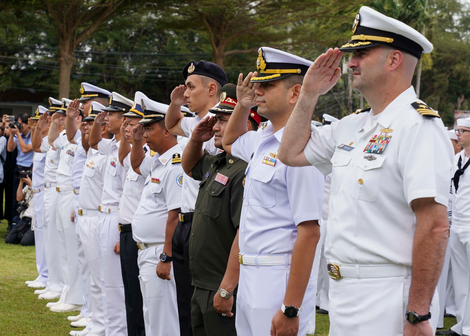 SATTAHIP, Thailand (Sept. 2, 2019) - U.S. Navy Sailors and maritime forces of ASEAN member states salute while standing in formation together during the opening ceremony for the ASEAN-U.S. Maritime Exercise (AUMX) at Sattahip Naval Base.