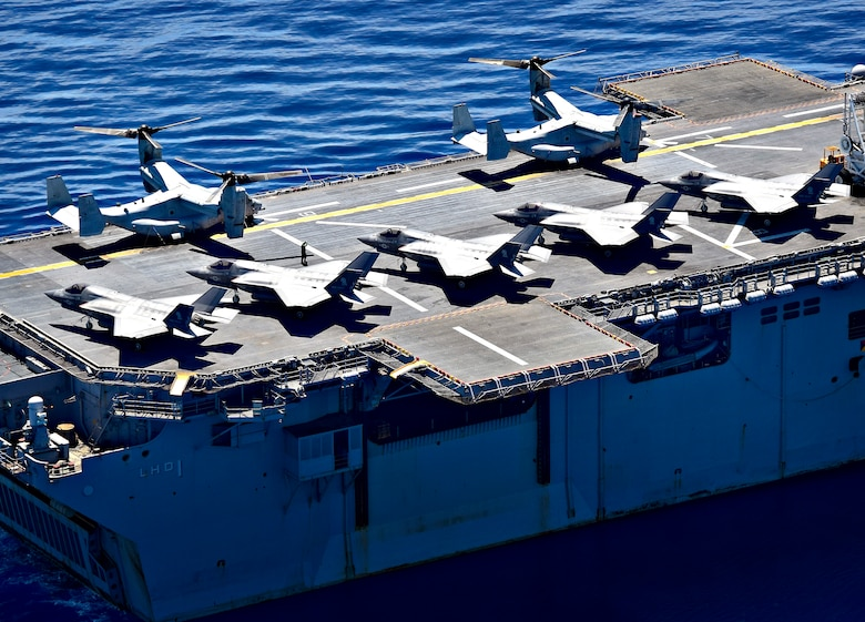 SOUTH CHINA SEA (March 29, 2019) F-35B Lightning II aircraft, assigned to Marine Fighter Attack Squadron (VMFA) 121, and MV-22 Osprey, assigned to Marine Medium Tiltrotor Squadron (VMM) 268, are secured to the flight deck aboard the amphibious assault ship USS Wasp (LHD 1). Wasp, flagship of Wasp Amphibious Ready Group, is operating in the Indo-Pacific region to enhance interoperability with partners and serve as a lethal, ready-response force for any type of contingency.