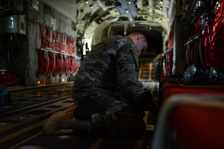 U.S. Air Force Airman Jaden Thompson, 86th Maintenance Squadron aerospace maintenance apprentice, secures seats in the back of aircraft 5840 at Ramstein air base, Germany, Aug. 29, 2019.