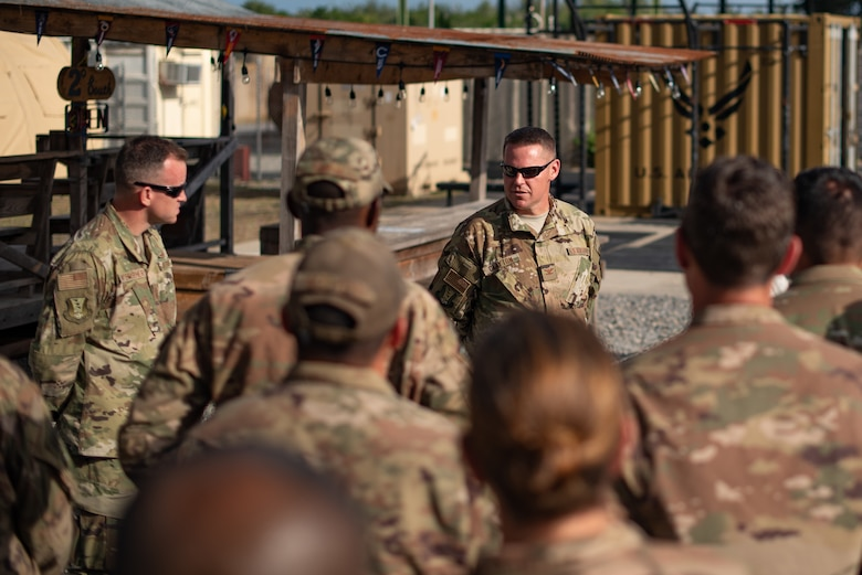 U.S. Air Force Col. Daniel C. Clayton, 435th Air Expeditionary Wing and 435th Air Ground Operations Wing commander, speaks with Airmen assigned to the 475th Expeditionary Air Base Squadron at Camp Simba, Kenya, Aug. 30, 2019. Clayton asked the Airmen what they needed to execute the mission more effectively and opened up the meeting for any questions they had. Clayton, and Chief Master Sgt. Jeremy Unterseher, 435th AEW and 435th AGOW command chief, visited each location in the area of responsibility as part of an immersion tour. (U.S. Air Force photo by Staff Sgt. Devin Boyer)