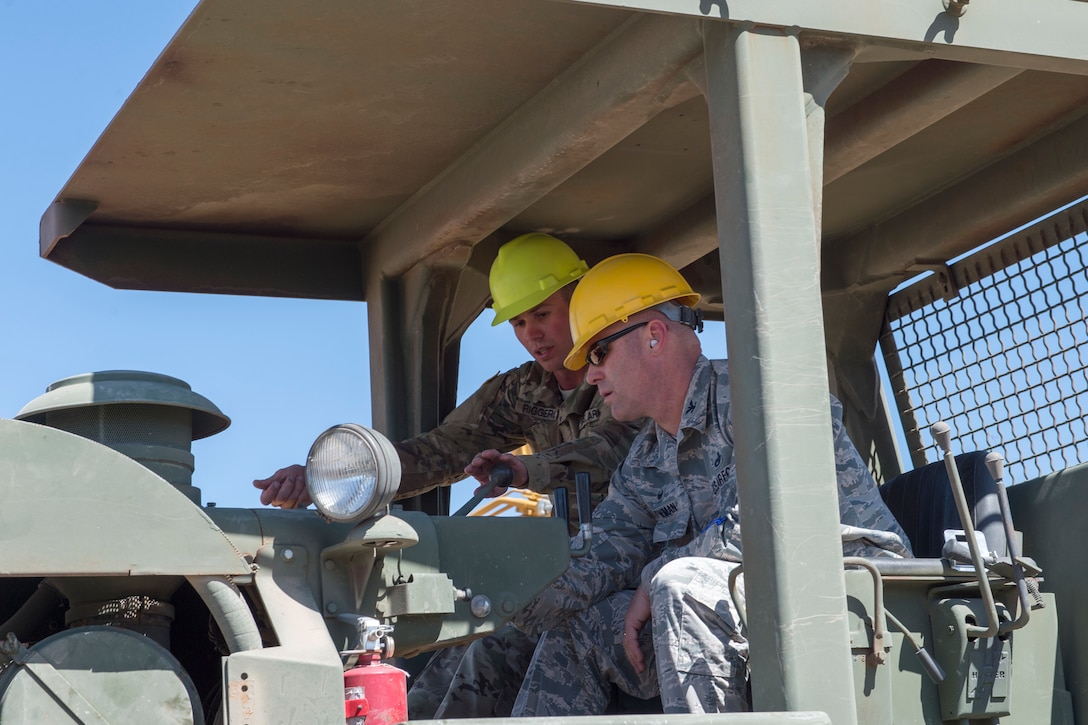 U.S. Air Force Col. Eric Newman, the vice commander of the 124th Fighter Wing, Idaho Air National Guard, tests out heavy equipment during a visit with the 124 FW Civil Engineer Squadron at the Shoshone-Paiute Tribe Aug. 26, 2019. The 128 FW CES was participating in joint-force Innovative Readiness Training where they helped to repair and build new roads for the Shoshone-Paiute Reservation. (U.S. Air National Guard photo by Senior Airman Mercedee Wilds)