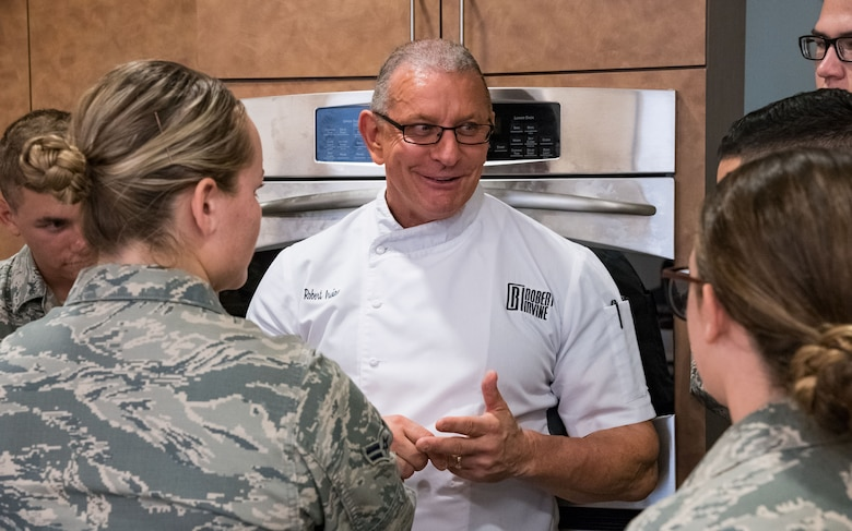 Chef Robert Irvine talks with Airmen at the end of Dorm to Gourm, Aug. 27, 2019, at Dover Air Force Base, Del. Irvine gave his views about career and life choices. (U.S. Air Force photo by Roland Balik)