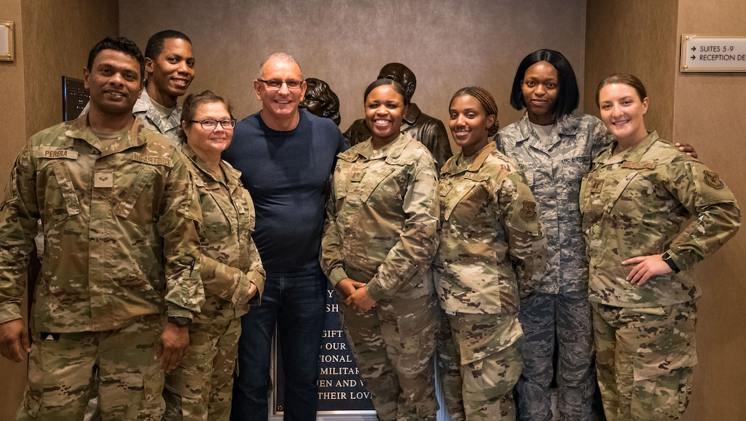 Chef Robert Irvine and Air Force Mortuary Affairs Operations personnel pose for a photo, Aug. 27, 2019, at the Fisher House on Dover Air Force Base, Del. Irvine toured the Fisher House and was briefed on its history. (U.S. Air Force photo by Roland Balik)