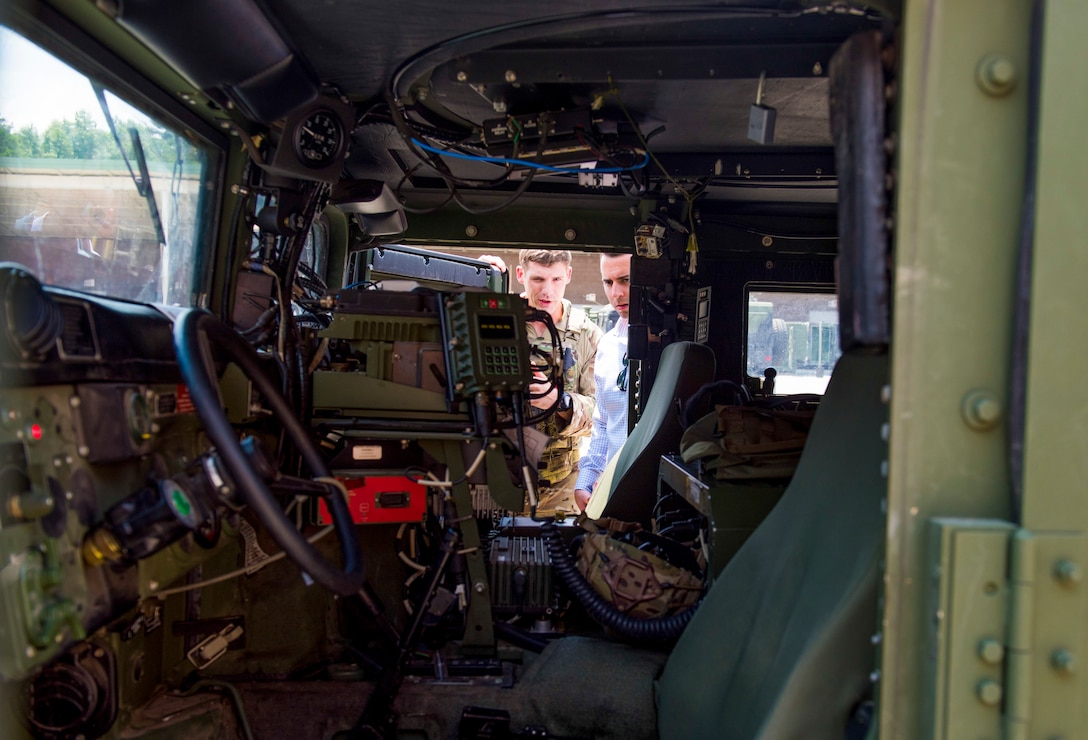 A U.S. Air Force joint terminal attack controller, assigned to the 165th Air Support Squadron, Georgia Air National Guard, performs a sound check while giving a presentation of their communication system installed in their Humvee called a Battlefield Airman System of Integrated Communications (BASIC) in Savannah, Ga., on August 13, 2019. The BASIC allows JTAC airmen to establish communications on multiple frequencies including HF, UHF, VHF, FM and SATCOM radios all while being protected from harsh conditions in an armored vehicle following a natural disaster. (U.S. Air National Guard photo by Staff Sgt. Caila Arahood)