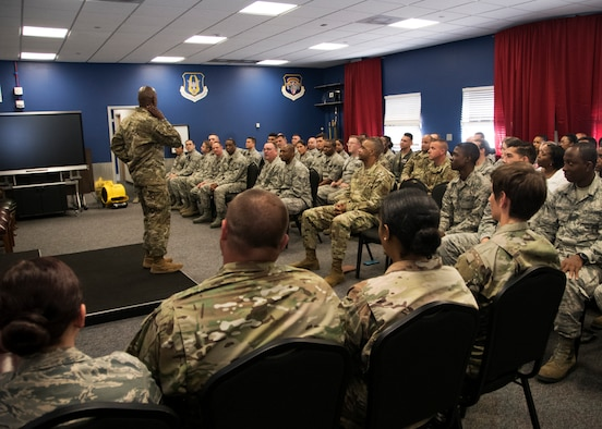 Chief Master Sergeant of the Air Force Kaleth O. Wright briefs members of the 459th Air Refueling Wing during an all-call Aug. 12, 2019, at Joint Base Andrews, Md. During his visit, Wright was shown a KC-135 Stratotanker by members of the 459th Aircraft Maintenance prior to holding an all call where he addressed issues happening in today's Air Force. (U.S. Air Force photo by Staff Sgt. Cierra Presentado/Released)