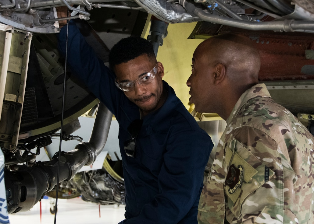 Chief Master Sergeant of the Air Force Kaleth O. Wright looks on as a member of the 459th Maintenance Group performs maintenance on a KC-135 Stratotanker during a visit to the wing Aug. 12, 2019, at Joint Base Andrews, Md. During his visit, Wright was shown a KC-135 Stratotanker by members of the 459th MXG prior to holding an all call where he addressed issues happening in today's Air Force. (U.S. Air Force photo by Staff Sgt. Cierra Presentado/Released)