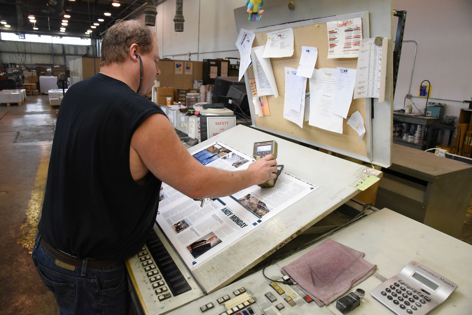 Everett E. (Skip) Craig Jr., press operator at KB Offset Printing Inc. in State College, Pennsylvania, measures the degree of darkness of the reflecting surface on a page of Loglines magazine during the final press run Aug. 26. The magazine's print version ends with the September/October 2019 issue. Photo by Phil Prater