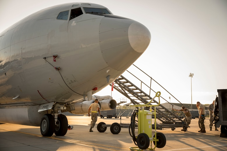 Airmen adjust a maintenance stand on an E-8C Joint STARS aircraft at Robins Air Force Base, Ga., Sept. 2, 2019, ahead of Hurricane Dorian. The Joint STARS aircraft belonging to the Georgia Air National Guard's 116th Air Control Wing, relocated to Tinker Air Force Base, Okla., in preparation for Hurricane Dorian's potential arrival on the eastern coast of Georgia. (U.S. Air National Guard photo by 1st Lt. Dustin Cole)