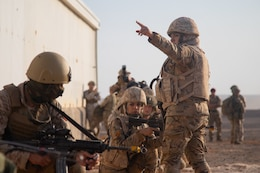 Jordan Armed Forces Warrant Officer Haneen Waqueez, Mohamed Bin Zayed Brigade/Quick Reaction Force Female Engagement Team, directs members of the FET where they are going to next during a coalition situational training exercise lane during Exercise Eager Lion 19, near Amman, Jordan on Sept. 3, 2019. The JAF FET were integrated into the JAF 81st Rapid Intervention Battalion alongside with the 3 Parachute Regiment, 3rd Battalion.