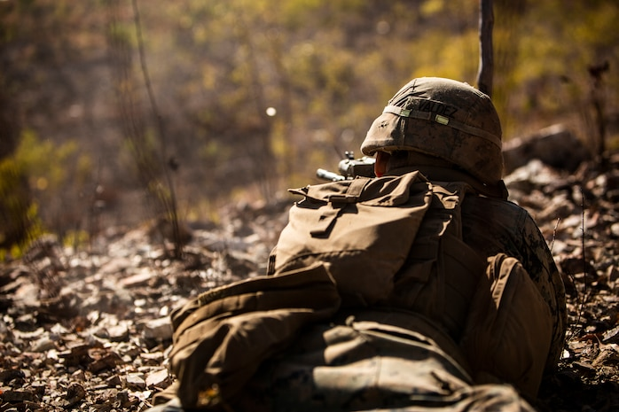 U.S. Marine Cpl. Gabriel Valdez, a rifleman with the Ground Combat Element, Marine Rotational Force - Darwin, fires a round during a platoon attack as a part of Exercise Koolendong at Mount Bundey Training Area, NT, Australia, Aug. 22, 2019. Koolendong is a live-fire bilateral exercise conducted to increase interoperability between U.S. Marines and the Australian Defence Force.