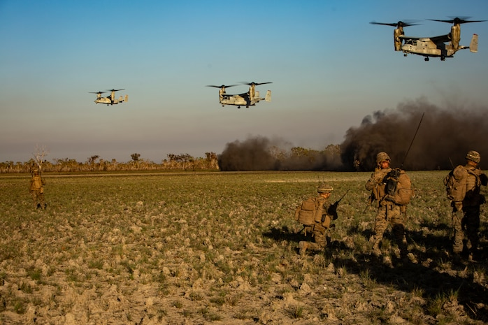U.S. Marines with the Ground Combat Element, Marine Rotational Force - Darwin, await to be inserted via MV-22 Ospreys during a company raid in Exercise Koolendong at Mount Bundey Training Area, NT, Australia, Aug. 23, 2019. Koolendong is a live-fire bilateral exercise conducted to increase interoperability between U.S. Marines and the Australian Defence Force.
