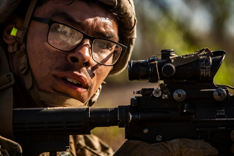U.S. Marine Lance Cpl. Daniel Ortega, a rifleman with the Ground Combat Element, Marine Rotational Force - Darwin, provides security during a company raid a part of Exercise Koolendong at Mount Bundey Training Area, NT, Australia, Aug. 22, 2019. Koolendong is a live-fire bilateral exercise conducted to increase interoperability between U.S. Marines and the Australian Defence Force.