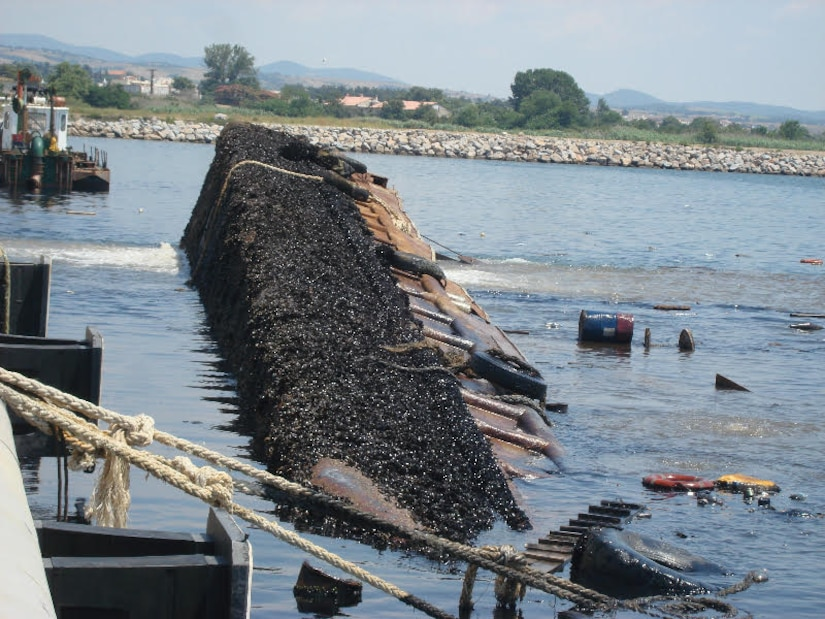 Dredge Barge Olga lays sunken in Harbor