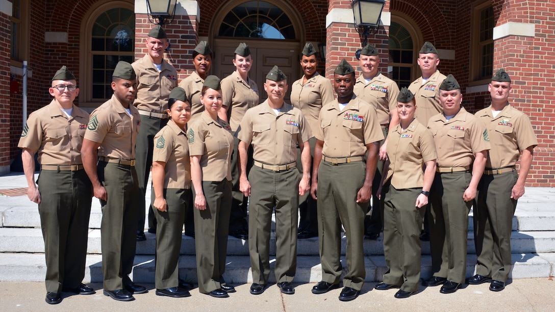 "DLA Aviation's Marine Corps Customer Facing Division servicemembers pose for a picture at Defense Supply Center Richmond, Virginia, May 30. When the Marines return to their operational units, they'll have an understanding of how ""big"" DLA works and the ability to train and advise their fellow Marines in DLA procurement processes. Photo by Jackie Roberts"