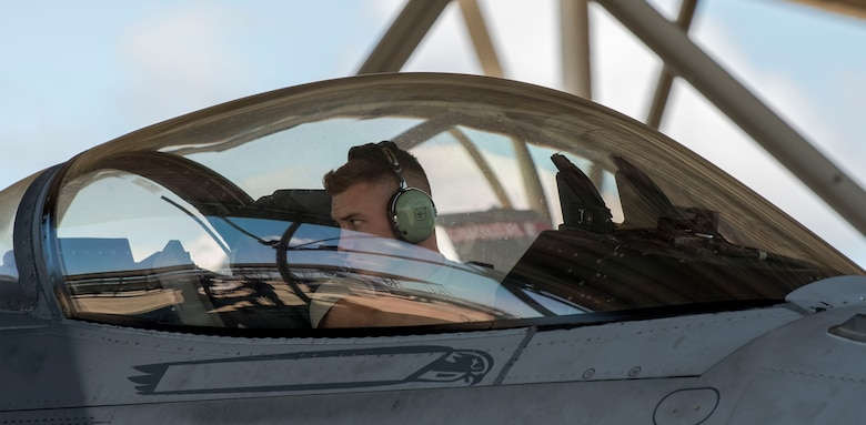A U.S. Air Force Airmen from the 20th Fighter Wing inspects the wing of an F-16 Viper before Hurricane Dorian's arrival at Shaw Air Force Base, South Carolina, Sept. 3, 2019.