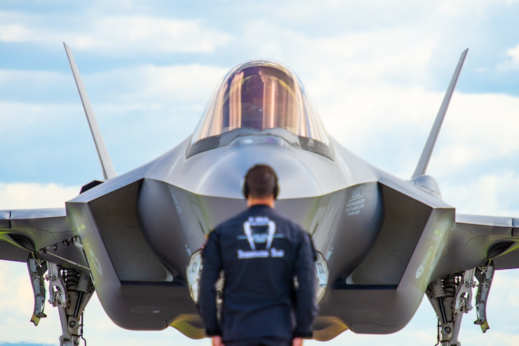 "A Member of the F-35A Lightning II Demonstration Team prepares to launch Capt. Andrew ""Dojo"" Olson, F-35 pilot, during the Bagotville International Air Show in Quebec, Canada, June 22, 2019. The team performed during both days of the air show. (U.S. Air Force photo by Staff Sgt. Jensen Stidham)"