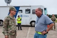 Lt. Col. Erik Verhoef, with U.S. Army Reserve Homeland Operations, talks with Jeff Glass, a FEMA field supervisor for national staging  during Hurricane Dorian preparations at Simmons Army Airfield, Sept. 4, 2019, at Fort Bragg, NC. A generator rolls into Simmons Army Airfield during Hurricane Dorian preparations, Sept. 4, 2019, at Fort Bragg, NC. U.S. Army Reserve Emergency Preparedness Liaison Officers (EPLOs) coordinate disaster recovery efforts with federal, state, and local agencies. For Hurricane Dorian, Col. Kevin Embry, a U.S. Army Reserve EPLO, and his team are working with FEMA and Fort Bragg officials as Hurricane Dorian moves up the eastern U.S. coast. (U.S. Army Reserve photo by Timothy L. Hale)