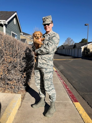 2nd Lt. Justin Davidson-Beebe, 21st Space Wing public affairs officer, poses for a photo with his dog Butters March 20, 2019 at Peterson Air Force Base, Colorado. He said that Butters and the other dogs he's had through his life help him maintain his resilience because of their innate enthusiasm. (U.S. Air Force courtesy photo)