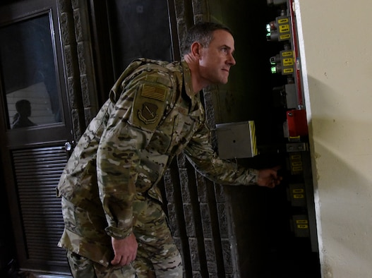 Col. Thomas Falzarano, 21st Space Wing commander, pushes the button to close one of the giant blast doors made of concrete and steel in Cheyenne Mountain Air Force Station, Colorado on Aug. 16, 2019. CMAFS has a primary role of collecting information from satellites and ground-based sensors throughout the world and disseminating the data to North American Aerospace Defense Command, U.S. Northern Command and U.S. Strategic Command. (U.S. Air Force photo by Staff Sgt. Alexandra M. Longfellow)