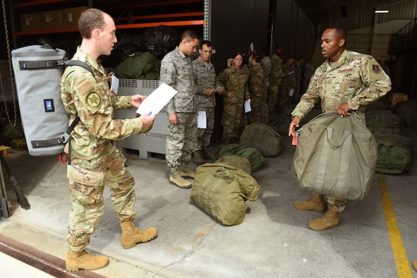 Master Sgt. Lamar Anderson, 169th Logistics Readiness Squadron, right, issues equipment to the initial group of 32 Airmen from the South Carolina Air National Guard's 169th Fighter Wing at McEntire Joint National Guard Base, Eastover, S.C. as they prepare to depart for Bluffton, SC., Sept. 1, 2019. Once there, they will provide Hurricane Dorian response support to civilian partners. South Carolina National Guard Soldiers and Airmen from units across the state prepare to respond as needed, in support of the potential impact of Hurricane Dorian to the state. (U.S. Air National Guard photo by Senior Master Sgt. Edward Snyder, 169th Fighter Wing Public Affairs)