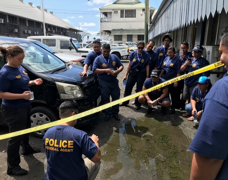 Special Agent Michelle Kiyota, left, explains the proper use of dental stone, which enables the recovery of footprints, during the AFOSI FIR 6 SMB Subject Matter Expert Exchange with Samoan law enforcement partners Aug. 20-22, 2019. (FIR 6/SMB photo)