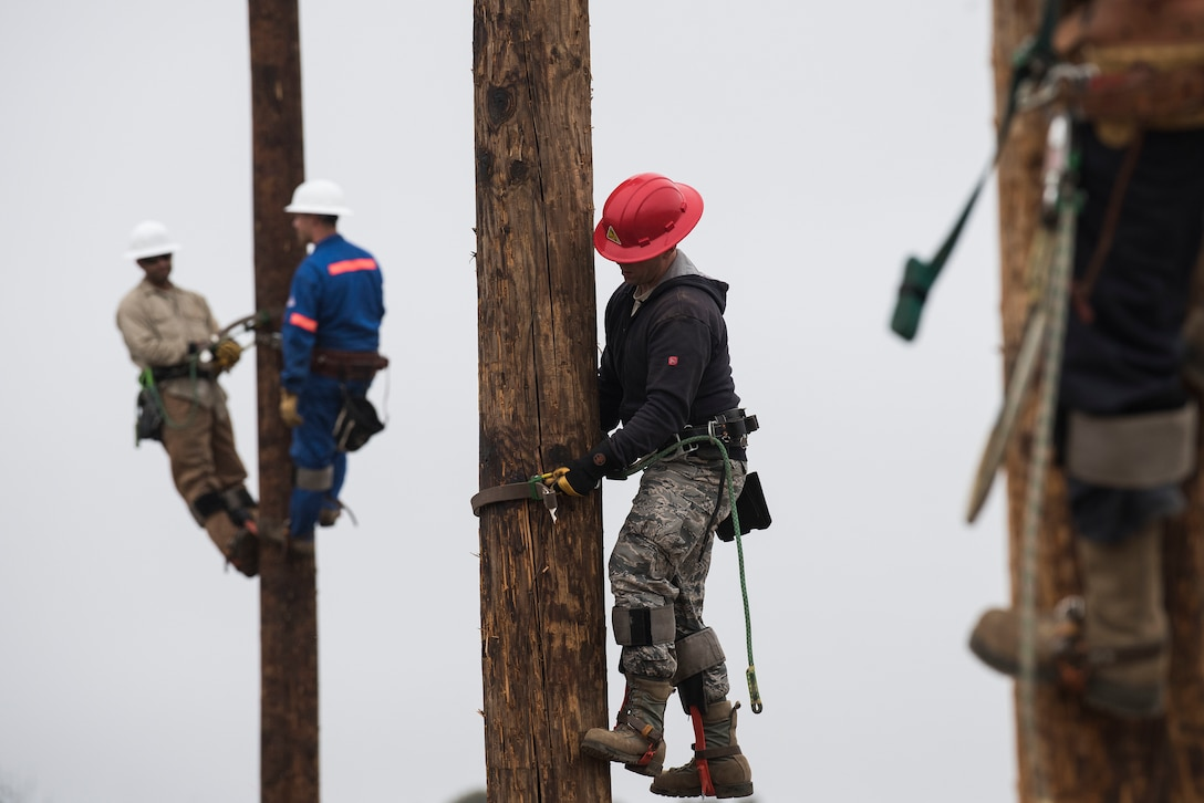 Airmen assigned to 30th Civil Engineer Squadron prepare for pole-top rescue training Aug. 23, 2019, at Vandenberg Air Force Base, Calif. During their weekly pole-top rescue training, the Airmen practice emergency life-saving maneuvers to retrieve members who may become injured while working on a power pole. The Airmen also practice confined space rescue and bucket truck rescue to ensure each Airmen is prepared during an emergency situation. (U.S. Air Force photo by Hanah Abercrombie)