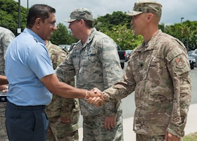 Air Vice Marshal Sudarshana Pathirana, Sri Lanka air force chief of staff, is greeted by members of the 15th Maintenance Group at Joint Base Pearl Harbor-Hickam, Hawaii, Aug. 20, 2019. During the four-day visit, SLAF and U.S. Air Force senior leaders engaged in three different working groups; humanitarian assistance and disaster relief, air and maritime domain awareness, and force development. (U.S. Air Force photo by Staff Sgt. Mikaley Kline)