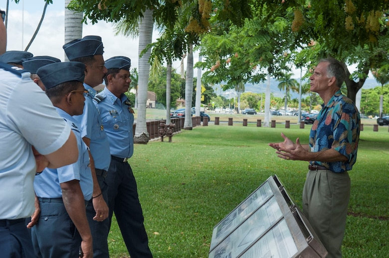 Charles Nicholls, Pacific Air Forces historian, gives a history tour to senior leaders of the Sri Lanka air force at Headquarters PACAF, Joint Base Pearl Harbor-Hickam, Hawaii, Aug. 22, 2019. During the four-day visit, SLAF and U.S. Air Force senior leaders engaged in three different working groups; humanitarian assistance and disaster relief, air and maritime domain awareness, and force development. (U.S. Air Force photo by Staff Sgt. Mikaley Kline)