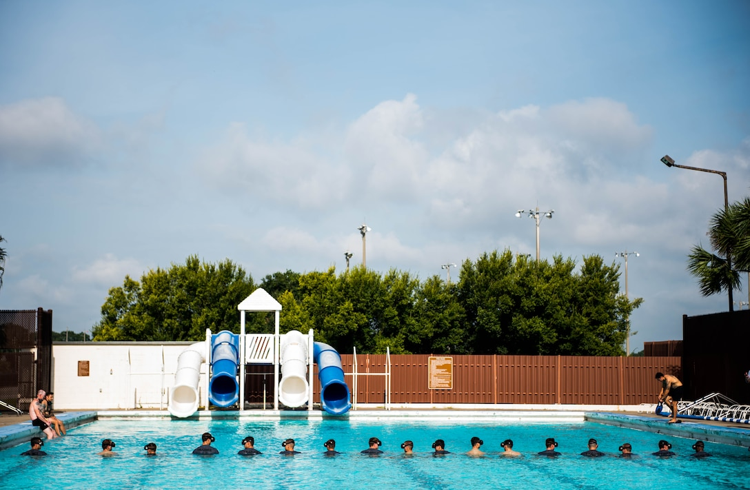 Special Warfare training students from the 352nd Special Warfare Training Squadron participate in a memorial physical training session at the Triangle Pool on Keesler Air Force Base, Mississippi, Aug. 9, 2019. The PT event was in memory of U.S. Air Force Staff Sgt. Andrew Harvell, combat controller, who was killed in action on Aug. 6, 2011. Special Warfare trainees attend combat controller and special reconnaissance courses in the 334th and 335th Training Squadrons. (U.S. Air Force photo by Sarah Loicano)