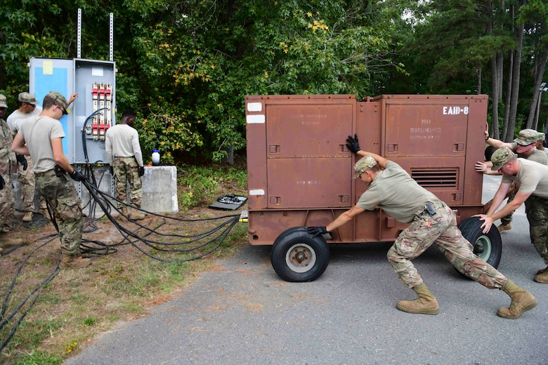 Airmen from the 4th Electrical Engineer Squadron and 567th Red Horse Squadron set up a generator for the military working dog kennels before Hurricane Dorian, Sept. 4, 2019, at Seymour Johnson Air Force Base, North Carolina. The 4th CES, to include equipment operators, electricians, plumbers, structural craftsman, heating, ventilation and air conditioning, and production technicians, are providing 24-hour response and recovery operations during and following Hurricane Dorian. (U.S. Air Force photo by Senior Airman Boyton)