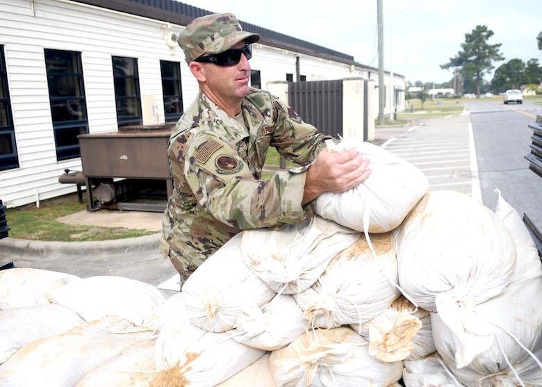 Seymour Johnson Air Force Base, N.C. — Tech Sgt Thomas Hartt, 4th Civil Engineer Squadron pavement and production specialist, unloads sand bags from a truck Sept. 4, 2019, at Seymour Johnson Air Force Base, North Carolina. Airmen and their families assigned to Seymour Johnson AFB prepared the installation for possible hurricane winds associated with Hurricane Dorian. (U.S. Air Force photo by Staff Sgt. Michael Charles)