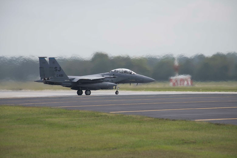 An F-15E Strike Eagle prepares to takeoff during a repositioning in advance of Hurricane Dorian, September 4, 2019, at Seymour Johnson Air Force Base, North Carolina. More than 30 aircraft were repositioned to Tinker AFB, Oklahoma, as a precautionary measure to avoid severe weather associated with Hurricane Dorian. (U.S. Air Force photo by Senior Airman Kenneth Boyton)