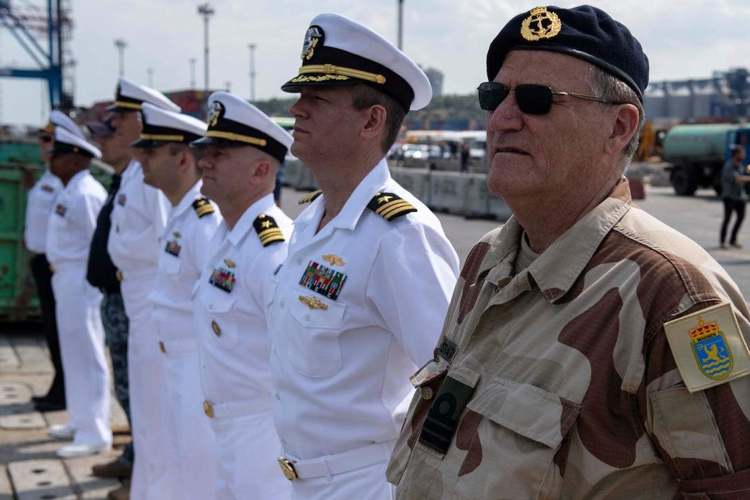 Sailors stand at ease.